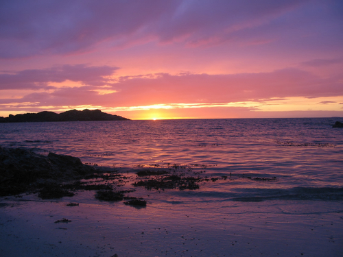 Picture of IONA, Hebrides - Sunset over the Isle of IONA. | PlanetWare