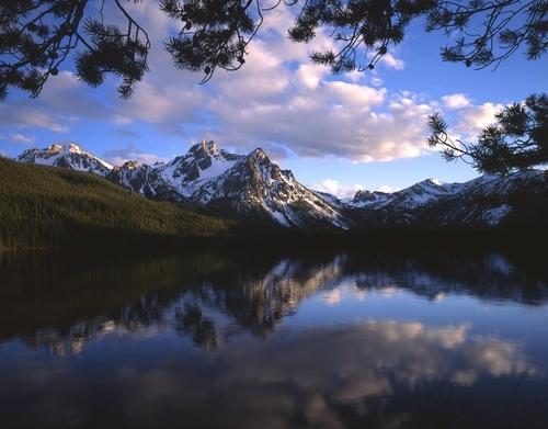 Mt. McGown reflecting in a lake in Sawtooth National Forest.