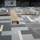 Picture - Patterned stone work and wood benches at the 16th Street Mall in Denver.