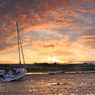 Picture - Boat at sunset at Alnmouth Estuary.