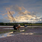 Picture - Sailboat on the shore at Alnmouth.