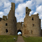 Picture - Ruins of the Dunstanburgh Castle gatehouse and keep.