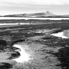 Picture - View from Embleston beach to Dunstanburgh Castle.