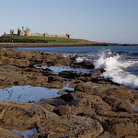 Picture - Shoreline in front of Dunstanburgh Castle in Alnwick.