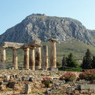 Picture - Temple of Apollo seen against Acrocorinth in Ancient Corinth.