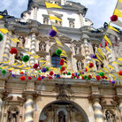 Picture - Flags and decorations hanging off of the Church of San Francisco El Grande in Antigua Guatemala.