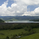 Picture - View of Lake Arenal and grassy hills.
