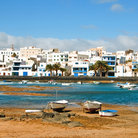 Picture - The white painted buildings of Arrecife seen from the water.
