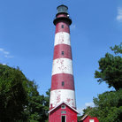Picture - The red and white Assateague Lighthouse.