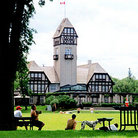 Picture - Winnipeger's picnic & play at Assiniboine Park with The Pavillion in background.