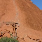 Picture - People walking up Ayers Rock.