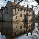 Picture - Baddesley House reflecting the in surrounding water in Solihul.