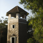 Picture - A brick tower in a park on Bald Head Island.