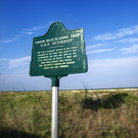 Picture - Historical marker on beach of Bald Head Island, North Carolina.