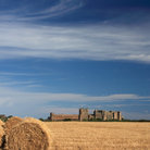 Picture - Hay bale in front of Bamburgh Castle.