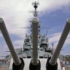 Picture - Guns of Battleship Massachusetts against Interstate Highway Bridge, Fall River, MA.