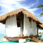 Picture - Thatched hut on the beach in Cancun.