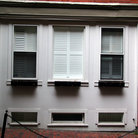 Picture - White windows on a red brick building in Beacon Hill, MA.
