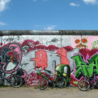 Picture - Bikes and graffiti on the Berlin Wall.