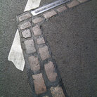 Picture - Indicators on the pavement showing where the Berlin Wall stood.