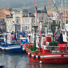 Picture - Fishing boats in the harbor at Bermeo.