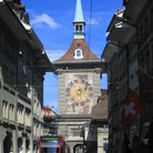 Picture - Tram in front of the Zytglogge Astronomic clock in Bern.