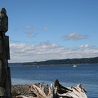 Picture - A totem pole on the ocean front at the Tillicum Indian Village at Blake Island State Park.