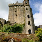 Picture - Exterior of Blarney Castle with the stone located where the sky shows through above the top window.