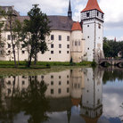 Picture - Tower of the Blatna Castle reflecting in the moat.