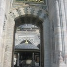 Picture - Entrance door inscribed with Quranic verses in the Blue Mosque.