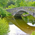 Picture - Stone bridge over the river Derwent at Grange in Borrowdale.