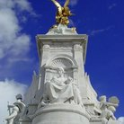 Picture - Elaborate sculptures of the Queen Victoria Memorial in front of Buckingham Palace in London.