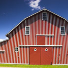 Picture - An old red and white striped barn at the Buffalo Bill State Historical Park at North Platte.