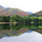 Picture - Mountains reflecting in Buttermere Lake.
