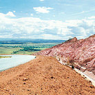 Picture - Pink rock cuts line near road through La Gran Sabana in Parque Nacional Canaima (Canaima National Park).