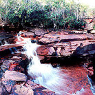 Picture - Red rock waterfall of Salto Kawí on La Gran Sabana in Parque Nacional Canaima (Canaima National Park).
