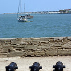 Picture - Canons at Castillo de San Marcos with sailboats in behind.