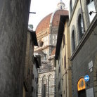 Picture - The Duomo through the narrow alleys in Florence.