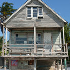 Picture - A wooden home on the beach at Caye Caulker.