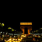 Picture - Champse Elysees at night in Paris.