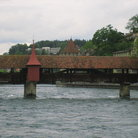 Picture - The Kapellbrucke (Chapel Bridge), a covered bridge diagonally across the River Reuss.