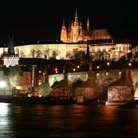Picture - Prague Castle and the Charles Bridge at night.