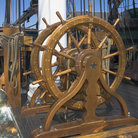 Picture - Wooden ship wheel of the USS Constitution in Boston.