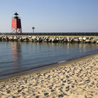 Picture - The beach and South Pier Lighthouse in Charlevoix.