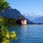 Picture - Chillon Castle with mountains behind.