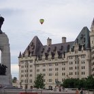 Picture - Chateau Laurier hotel and War Memorial in Ottawa.