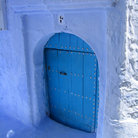 Picture - Blue door in a village of Chefchaouen.
