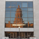 Picture - Reflection of the Wyoming State Capitol building seen in glass windows.