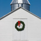 Picture - White barn with Christmas wreath at Chippokes Plantation State Park, Virginia.