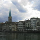 Picture - The Fraumunster Kirche (Church of Our Lady) in the background along the river in Zurich.